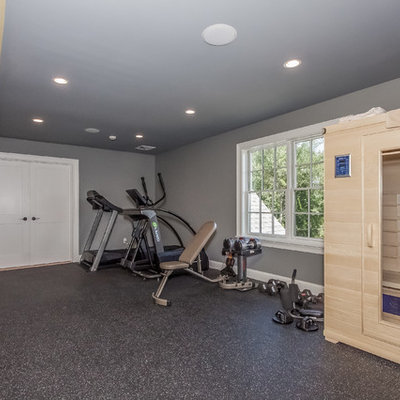Large minimalist home weight room photo in Boston with gray walls