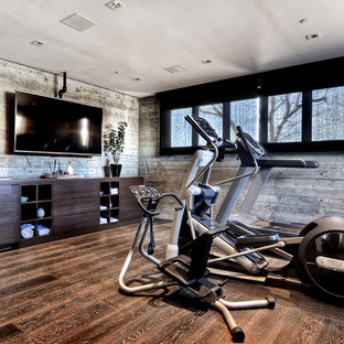 Inspiration for a large contemporary multi-use home gym in Orange County with medium hardwood flooring, grey walls and brown floors.