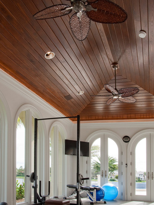 Inspiration For A Mediterranean Home Gym Remodel In Miami With White Walls