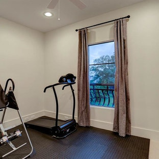 Design ideas for a large traditional multi-use home gym in Houston with white walls, brick flooring and white floors.