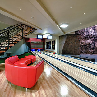 Design ideas for an expansive arts and crafts home climbing wall in Salt Lake City with beige walls and light hardwood floors.