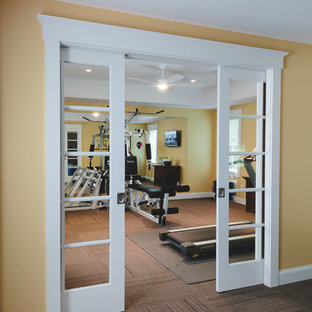 Photo of a nautical multi-use home gym in Atlanta with yellow walls and carpet.