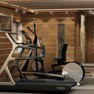 75 most popular home gym with light hardwood flooring and