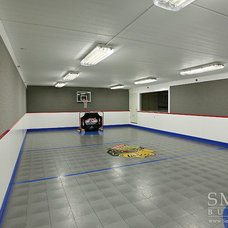 Transitional Home Gym by SMART Construction Group, Ltd.