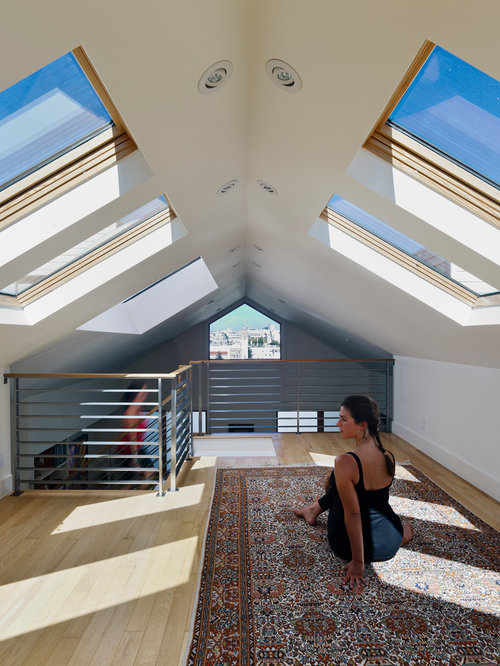 inspiration for a contemporary home yoga studio remodel in san francisco with white walls and light