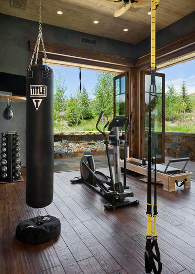 Rustic Home Gym by Locati Architects
