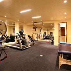 Mediterranean Home Gym by Prestige Builders