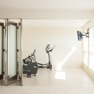 Contemporary home gym in Edmonton with white walls and white floors.