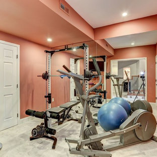 This is an example of a medium sized contemporary home weight room in DC Metro with orange walls, carpet and white floors.