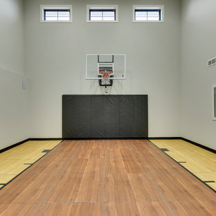 Inspiration for a large cottage brown floor and medium tone wood floor indoor sport court remodel in Minneapolis with gray walls