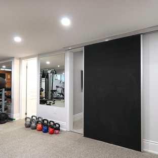 Inspiration for a large modern carpeted and gray floor home weight room remodel in Toronto with white walls