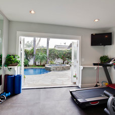 Traditional Home Gym by Lane Design + Build