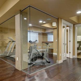 Mid-sized transitional multipurpose gym in Denver with beige walls, dark hardwood floors and brown floor.