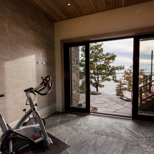 Photo of a small rustic home weight room in Toronto with white walls, slate flooring and grey floors.