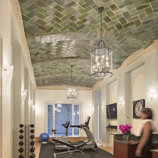 Large elegant light wood floor multiuse home gym photo in New York with multicolored walls
