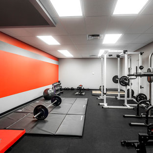 Home weight room - large modern black floor home weight room idea in Orlando with gray walls