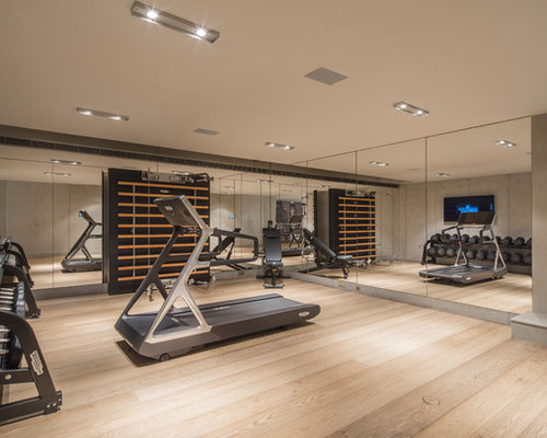 Inspiration For A Large Modern Multi Use Home Gym In London With Light  Hardwood Flooring