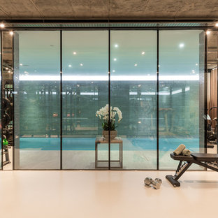 Design ideas for a contemporary multi-use home gym in London with white floors.