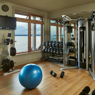 Design ideas for a beach style home gym in Seattle with orange floors.
