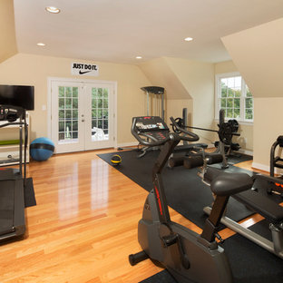 Mid-sized elegant light wood floor and orange floor multiuse home gym photo in Richmond with yellow walls