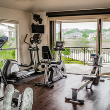Traditional Home Gym by Les Moore Construction, Inc.