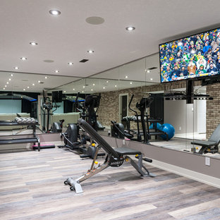Medium sized contemporary home weight room in Calgary with grey walls and porcelain flooring.