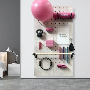 Exempel på ett litet modernt hemmagym med yogastudio, med vita väggar, betonggolv och grått golv