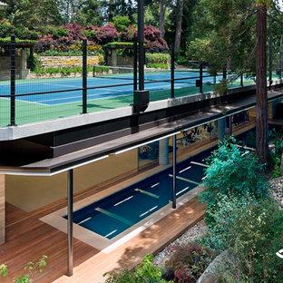 На фото: домашние тренажерные залы в современном стиле