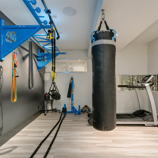 Design ideas for a small contemporary multi-use home gym in Toronto with grey walls, porcelain flooring and beige floors.