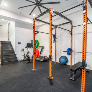 Large modern multipurpose gym in Chicago with white walls, vinyl floors, black floor and coffered.