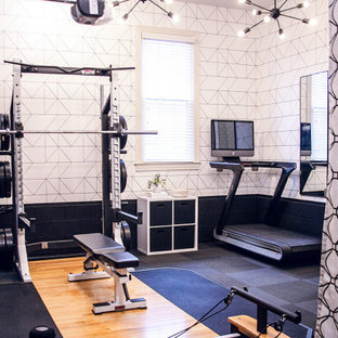 Example of a mid-sized minimalist black floor home weight room design in Nashville