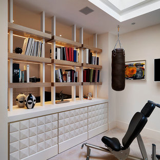 Photo of a large contemporary multi-use home gym in London with white walls.