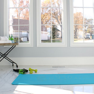 Large contemporary home yoga studio in Charlotte with grey walls, marble flooring and white floors.