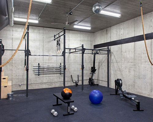 Example of an urban home weight room design in Minneapolis with gray ...