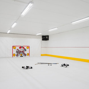 Contemporary indoor sports court in Minneapolis with white walls and white floors.