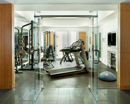 example of a minimalist home gym design in boston with white walls and