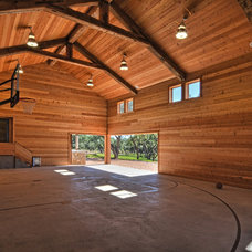 Rustic Home Gym by Cornerstone Architects