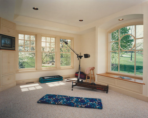 small transitional home yoga studio photo with white walls and carpet