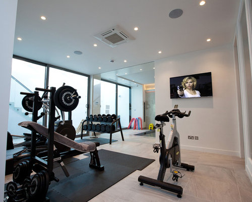 Design Ideas For A Small Contemporary Multi Use Home Gym In London With  White Walls