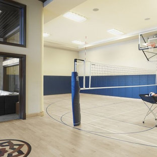 Inspiration for a large traditional indoor sport court in St Louis with white walls and light hardwood floors.