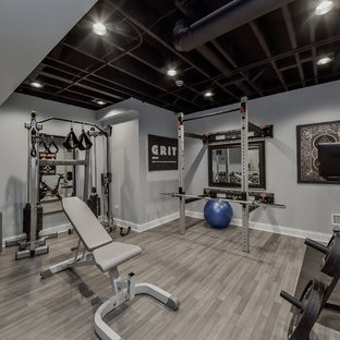 Example of a transitional gray floor home gym design in Chicago with gray walls