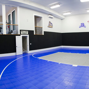 Inspiration for a huge timeless blue floor and vinyl floor indoor sport court remodel in Other with multicolored walls