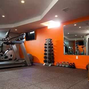 Most popular home gym with orange walls design ideas for
