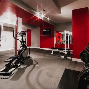 Immagine di una sala pesi minimal di medie dimensioni con pareti rosse