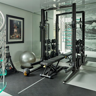 Design ideas for a large contemporary home gym in Hertfordshire with grey walls and grey floors.