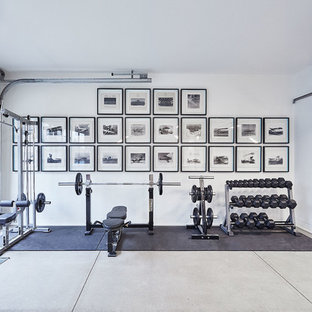 Inspiration for a modern concrete floor and gray floor home gym remodel in Toronto with white walls