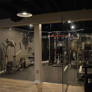 Home weight room - mid-sized modern home weight room idea in Detroit with beige walls