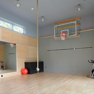 Indoor sport court - large modern light wood floor indoor sport court idea in Seattle with gray walls
