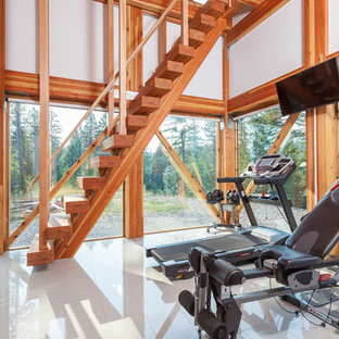 Photo of a contemporary multi-use home gym in Other with white walls and white floors.