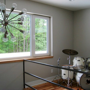 Example of a mid-sized minimalist home gym design in Raleigh